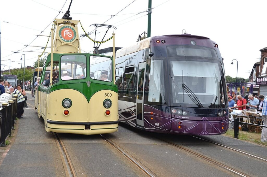 A Heritage Tram and a new tram, side by side in Fleetwood town centre, at Tram Sunday