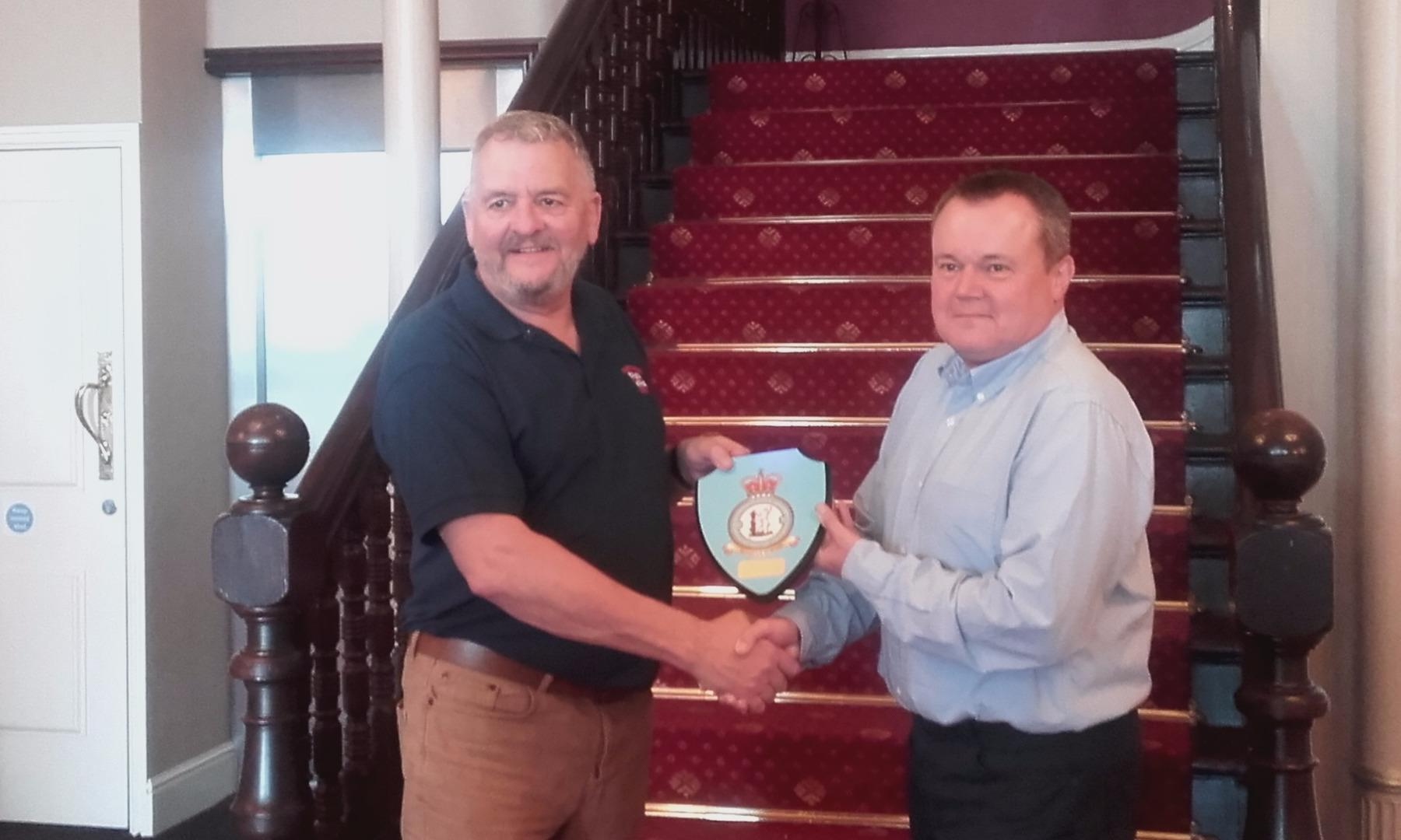 Fleetwood RNLI Captain David Eccles receiving the 605 Squadron shield from Wing Commander Paul Bell