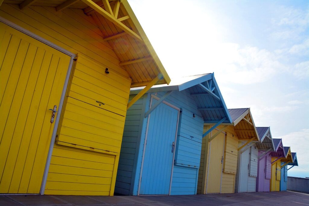 Pass the beach huts at Marine Beach when you go walking in Fleetwood