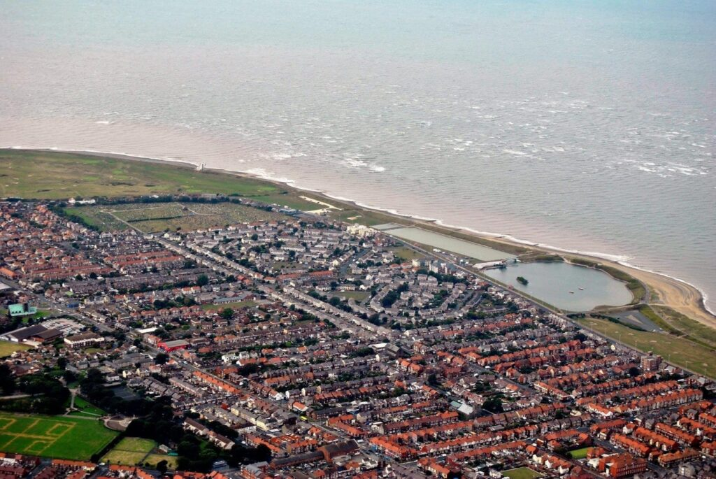 Aerial view from a plane of Fleetwood seafront in 2014, by Juliette Gregson