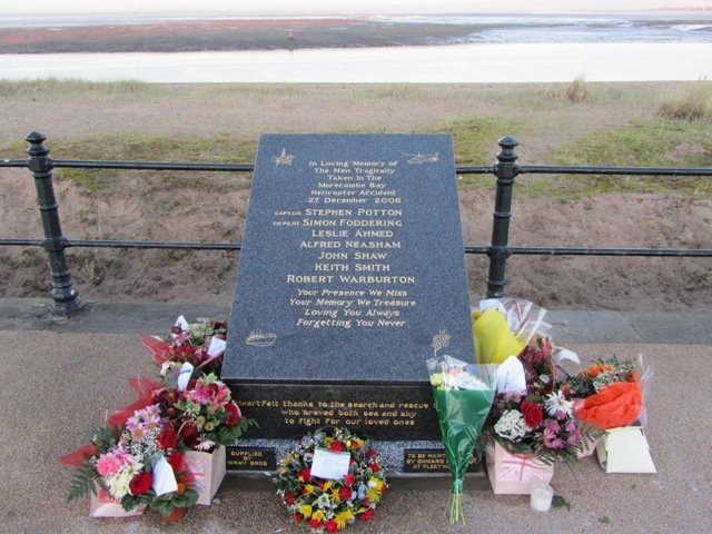 Memorial to Morecambe Bay helicopter tragedy on The Esplanade, Fleetwood against Ferry Beach