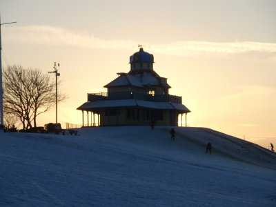 The Mount Pavilion on Fleetwood seafront, lit up at sunset in the snow