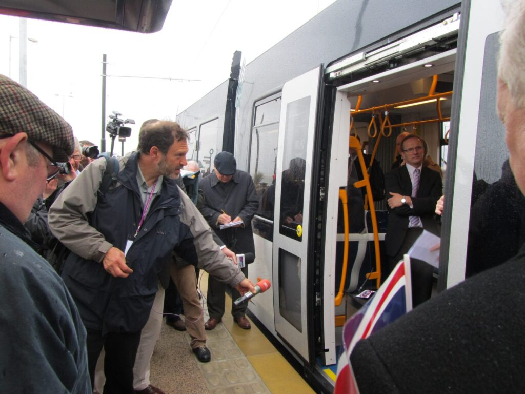 Steve Becker (RIP) at BBC Radio Lancashire greets the tram