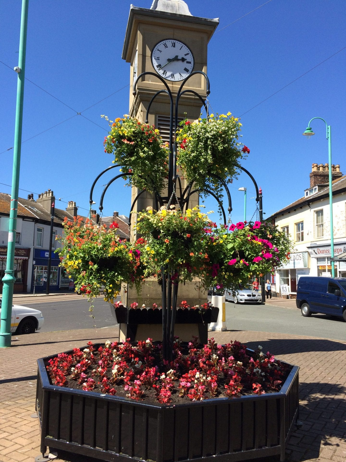Flower display at the clock near the market