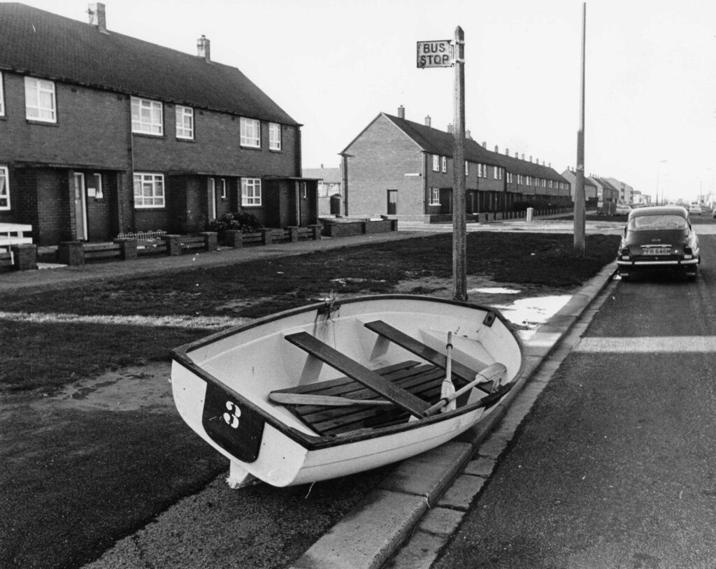 Boat left at a bus stop after flooding in Fleetwood in 1977