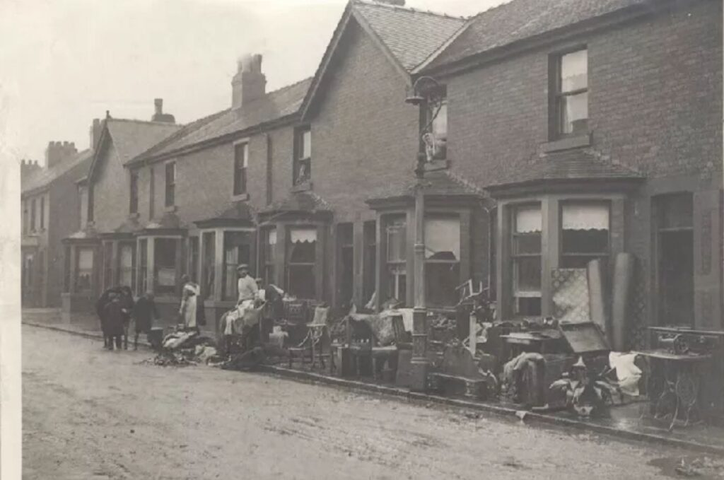 Wet and wrecked possessions piled up outside after flooding in Fleetwood in 1927
